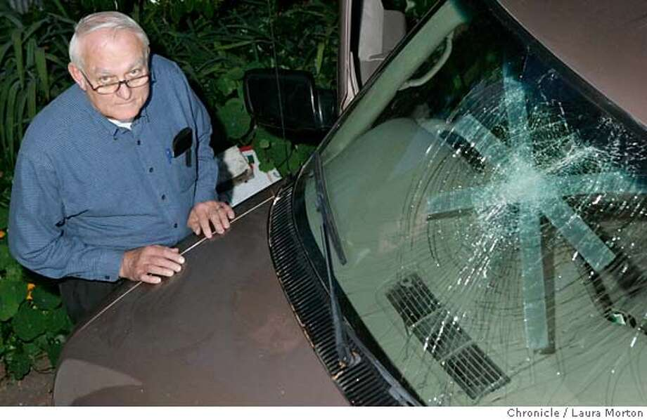 "BERKBIKES15_00003_LKM.JPG Longtime Berkeley resident Harlan Head stands with his van. The van's windshield was shattered Friday night when Head and his wife were surrounded in the vehicle by Critical Mass riders during their ride in Berkeley. Head hopes the Berkeley City Council will be able to come up with rules for the ride that will be both agreeable to motorists and Critical Mass riders. ""Streets are a limited asset and we need to share them,"" Head said. (Laura Morton/Special to the Chronicle) Photo: Laura Morton"