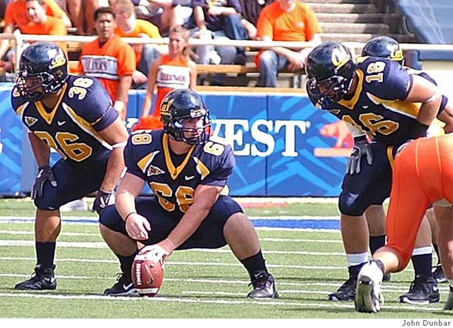 Action shot of Cal's Nick Sundberg, their long snapper, during a snap for punt. Photo by John Dunbar Photo: John Dunbar