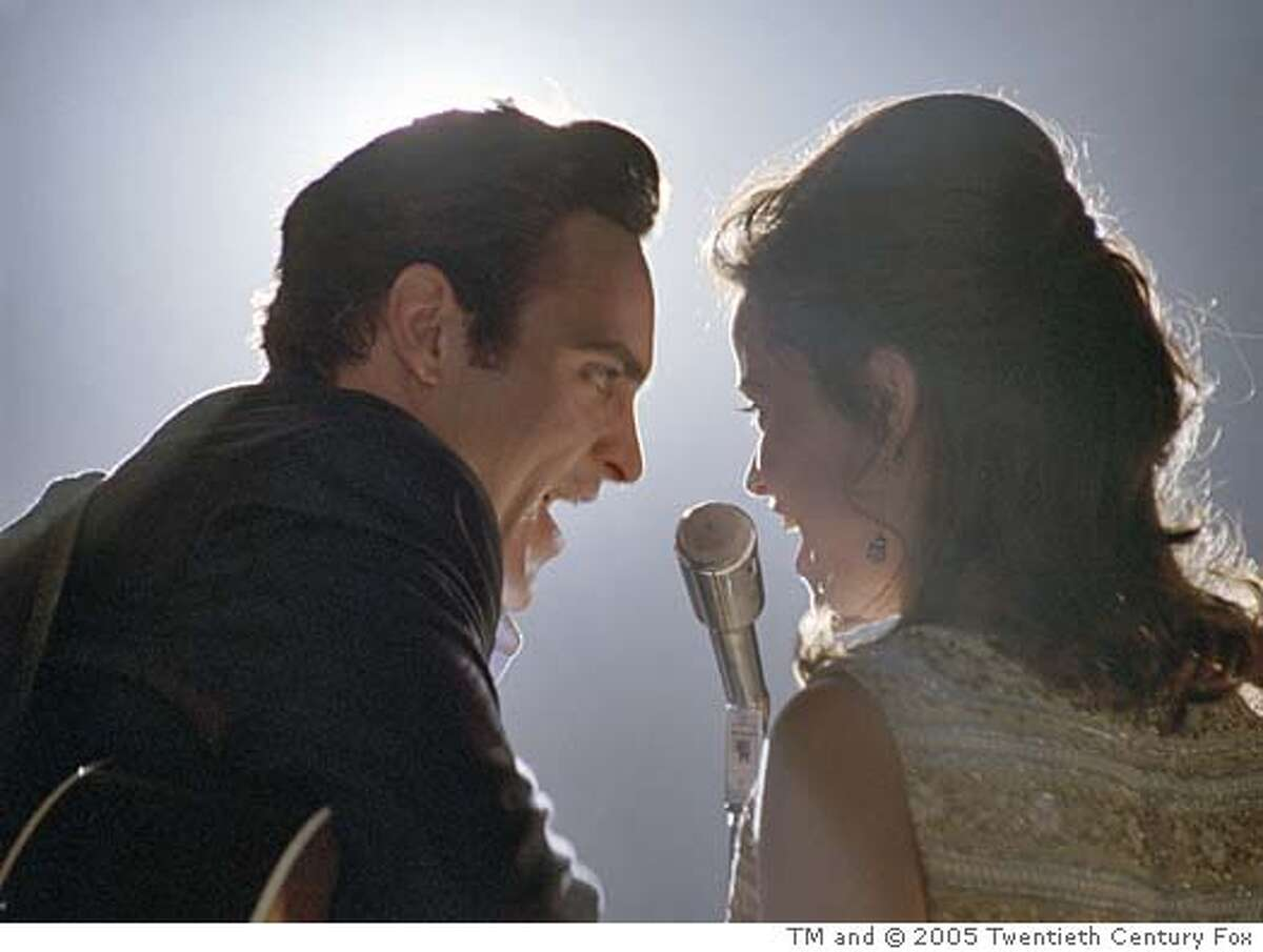 WALK18 Musicians Johnny Cash (Joaquin Phoenix) and June Carter (Reese Witherspoon) perform in WALK THE LINE. TM and � 2005 Twentieth Century Fox. All Rights Reserved. Not for sale or duplication.