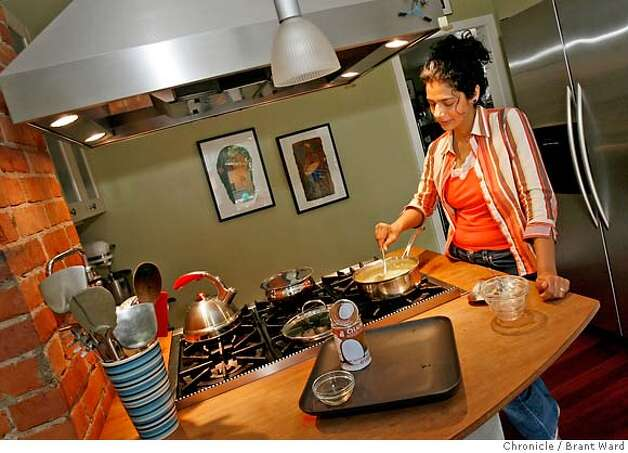 seasonal16_047.JPG  Having added all the ingredients, Ruta Kahate waits for the okra to get done in her curry dish.  Indian cooking teacher Ruta Kahate prepares her everyday okra-shrimp curry in the kitchen of her Oakland home.  {Brant Ward/San Francisco Chronicle}5/10/07 Photo: Brant Ward