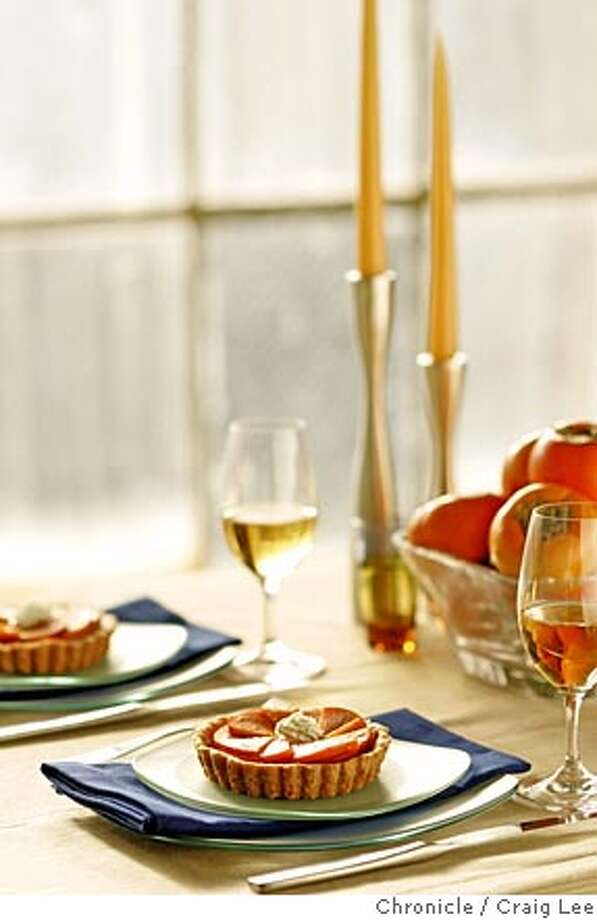 Thanksgiving desserts and the sweet wines that go with them. Photo of a persimmon/goat cheese tart and a glass of dessert wine. Styled by Ellie Winter.  Event on 11/4/05 in San Francisco. Craig Lee / The Chronicle Photo: Craig Lee