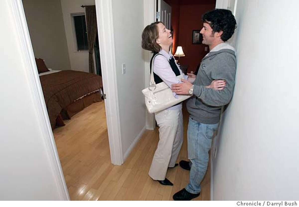 homes18_0033_db.jpg Newlywed home buyers Kathleen and Adam Bunshoft of San Francisco stop to talk in the hallway as they tour top floor condo at 2918 Anza Street in San Francisco offered at $689,000. Event on 11/16/05 in San Francisco. Darryl Bush / The Chronicle MANDATORY CREDIT FOR PHOTOG AND SF CHRONICLE/ -MAGS OUT