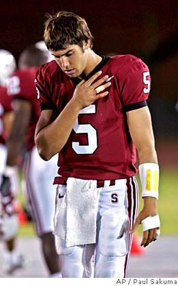 Stanford starting quarterback Trent Edwards holds up his hand against his chest on the sidelines in the second quarter against UC Davis after he was injured, Saturday, Sept. 17, 2005, in Stanford, Calif. (AP Photo/Paul Sakuma) Ran on: 09-20-2005  Walt Harris Ran on: 09-20-2005  Walt Harris Photo: PAUL SAKUMA