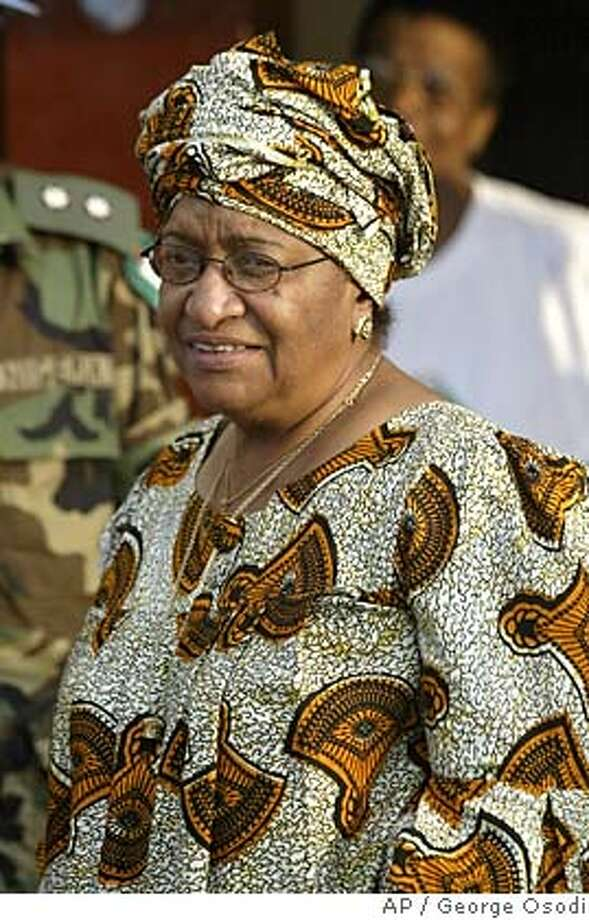 """Ellen Johnson-Sirleaf presidential candidate of the Unity Party (UP) walks towards her main house inside her compound in Monrovia, Liberia on Monday, Nov. 14, 2005. Ellen Johnson-Sirleaf is on the verge of making history, not just as Liberia's first female president, but the first in Africa, and one of a handful in the world. In an interview with The Associated Press, she says she hopes to be a role model that will inspire """"women, in Liberia, women in Africa, I hope even women in the world."""" (AP Photo/George Osodi) Photo: GEORGE OSODI"""