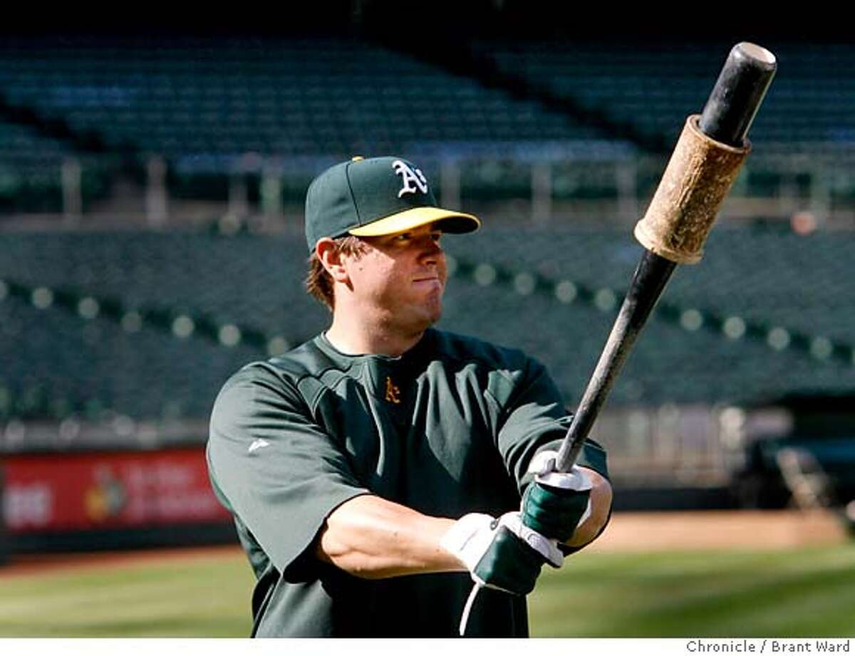 athletics370.JPG Jack Cust gets ready for batting practice Monday. Jack Cust, the designated hitter for the Oakland Athletics has been knocking the cover off the baseball lately and providing game winning homeruns like the one Sunday. {Brant Ward/San Francisco Chronicle}5/14/07