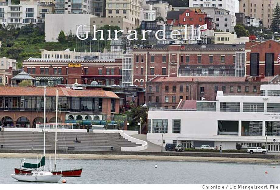 ghirardelli_011_LM.jpg Event on 5/6/03 in San Francisco.  Ghirardelli Square, the former chocolate factory that is one of SF's most popular tourist attractions, is very close to being put up for sale. Photo from the pier at Aquatic Park. also ran 03/20/2004 CAT MANDATORY CREDIT FOR PHOTOG AND SF CHRONICLE/ -MAGS OUT Photo: LIZ MANGELSDORF