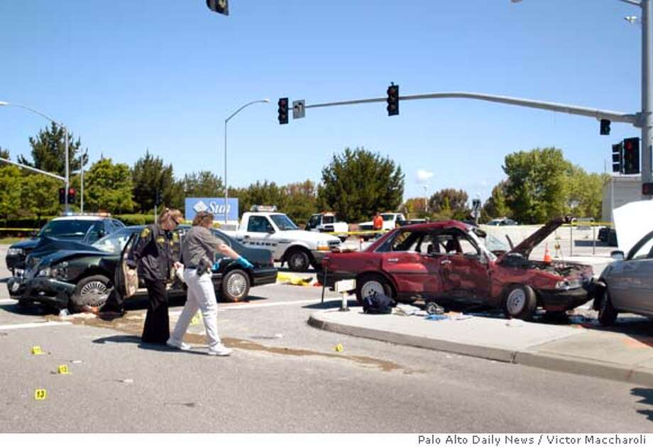Menlo Park police investigate the scene of a fatal three-car accident Monday, April 23, 2007, in Menlo Park, Calif. David Halberstam, a Pulitzer Prize-winning journalist and author who chronicled the Washington press corps, Vietnam and the world of sports, was killed in the crash according to his wife and local authorities. He was 73. (AP Photo/Palo Alto Daily News, Victor Maccharoli) ** NO SALES MAGS OUT MANDATORY CREDIT ** Photo: Victor Maccharoli