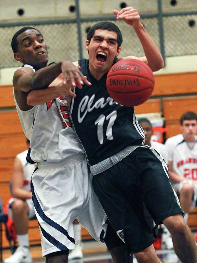 Clark guard Adam Perez is fouled under the basket by Brandeis' Justin Graham on Tuesday. Photo: TOM REEL, Express-News / © 2012 San Antonio Express-News  MAGS OUT; TV OUT; NO SALES; SAN ANTONIO OUT; AP MEMBERS ONLY; MANDATORY CREDIT; EFE OUT