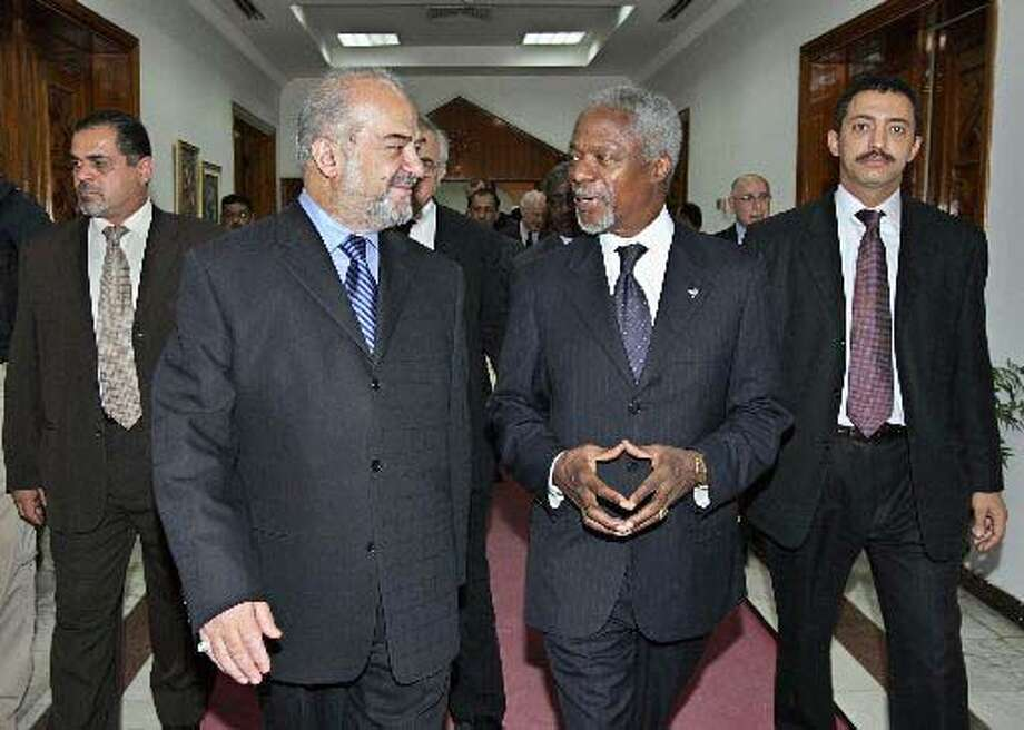 U.N. Secretary General Kofi Annan (second from right) talks with Prime Minister Ibrahim al-Jaafari during a brief trip to Iraq. Associated Press photo by Ali Haidar
