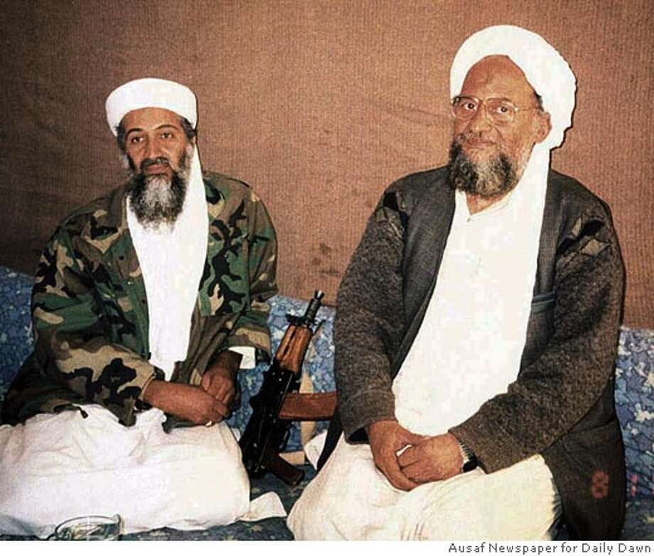 Osama bin Laden (L) sits with his adviser Ayman al-Zawahiri, an Egyptian reputed to be second in command of the al Qaeda network, during an interview with Pakistani journalist Hamid Mir (not pictured) in this file photo image supplied by the Dawn newspaper on November 10, 2001. Pakistani troops may have surrounded Zawahiri during a major battle on the wild Afghan frontier March 18, 2004. REUTERS/Hamid Mir/Editor/Ausaf Newspaper for Daily Dawn/FILE Osama bin Laden speaks to reporters in this 1998 photo taken in Khost, Afghanistan. ALSO RAN 3/28/04 0 Photo: HO
