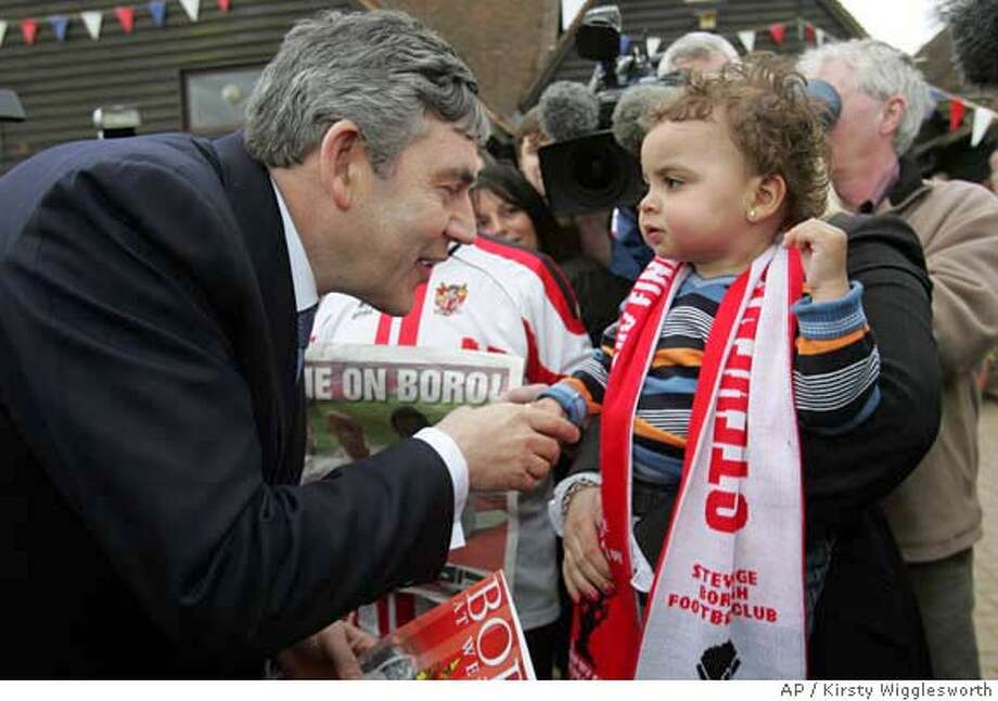 Britain's Chancellor Gordon Brown meets 19-month-old Marley Buckingham during a visit to Knebworth, England as he starts his campaign to run for Prime Minister of Britain, Friday May 11, 2007. (AP Photo/Kirsty Wigglesworth) Photo: KIRSTY WIGGLESWORTH