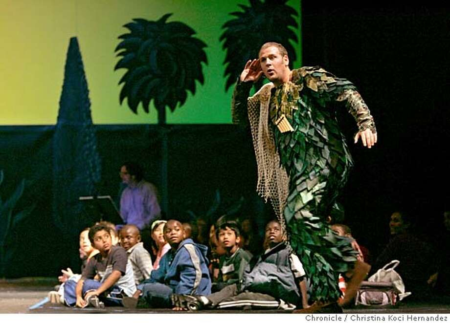 "CHRISTINA KOCI HERNANDEZ/CHRONICLE  Lucas meachem plays ""Papageno, as kids watch , sitting on stage.""SF Opera does a special meant-for-kids production of Mozart's Magic Flute -- one hour, in English, etc. -- and we need shot from final dress rehearsal to run with review. Please get the principal singers, and also try to get company General Director Pamela Rosenberg in her stage debut as, um, a tree. Photo: CHRISTINA KOCI HERNANDEZ"