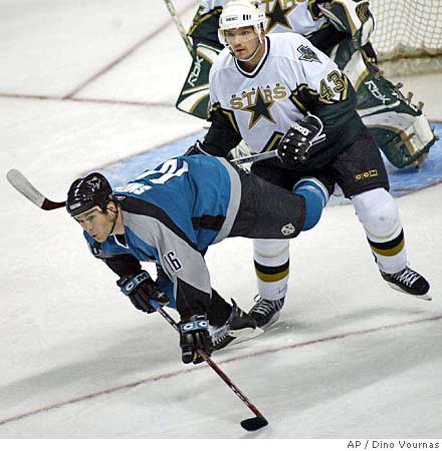 San Jose Sharks' Mark Smith is pushed over by Dallas Stars' Philippe Boucher during the third period of the Stars' 3-2 win Saturday, Nov. 12, 2005, in San Jose, Calif. (AP Photo/Dino Vournas) Photo: DINO VOURNAS