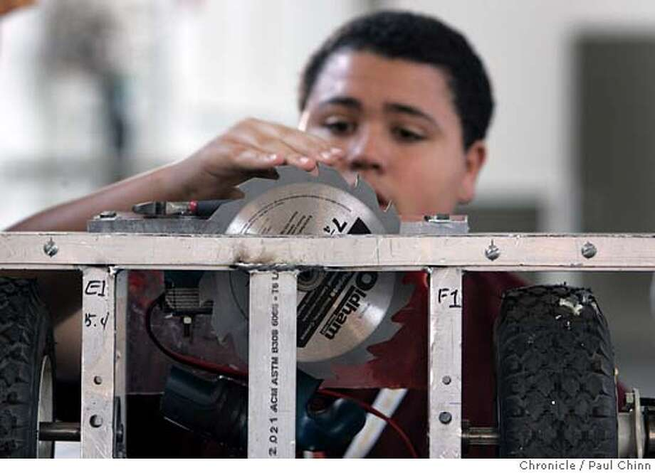 Kim Smith, of the Boilmakers team from John O'Connell High School, makes adjustments to his robot Enoch before the 2005 ComBots Cup and Robot Fighting League National Championship at Ft. Mason on 11/12/05 in San Francisco, Calif.  PAUL CHINN/The Chronicle Photo: PAUL CHINN