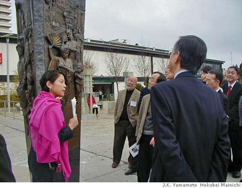 "Please credit ""J.K. Yamamoto, Hokubei Mainichi.""  Japantown tour. Diane Matsuda, executive officer of the California Cultural and Historical Endowment, explaining the Japantown monument to some participants at the conference between Japanese and Japanese-American leaders J.K. Yamamoto Hokubei Mainichi Photo: J.K. Yamamoto"