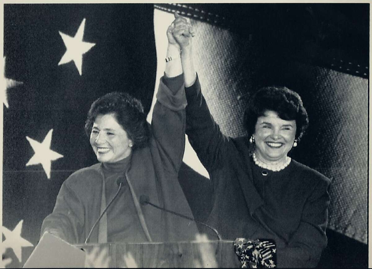 Barbara Boxer, left, and Dianne Feinstein join arms in victory after both won their bids for the U.S. Senate November 3, 1992. They will make history by becoming the first two women from the same state to serve in the Senate. Lou Demattaeis/Reuters