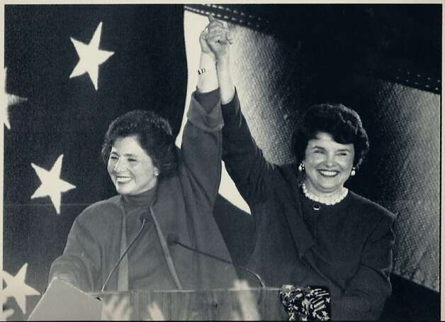 Barbara Boxer, left, and Dianne Feinstein join arms in victory after both won their bids for the U.S. Senate November 3, 1992. They will make history by becoming the first two women from the same state to serve in the Senate. Lou Demattaeis/Reuters Photo: Lou Demattaeis, Reuters