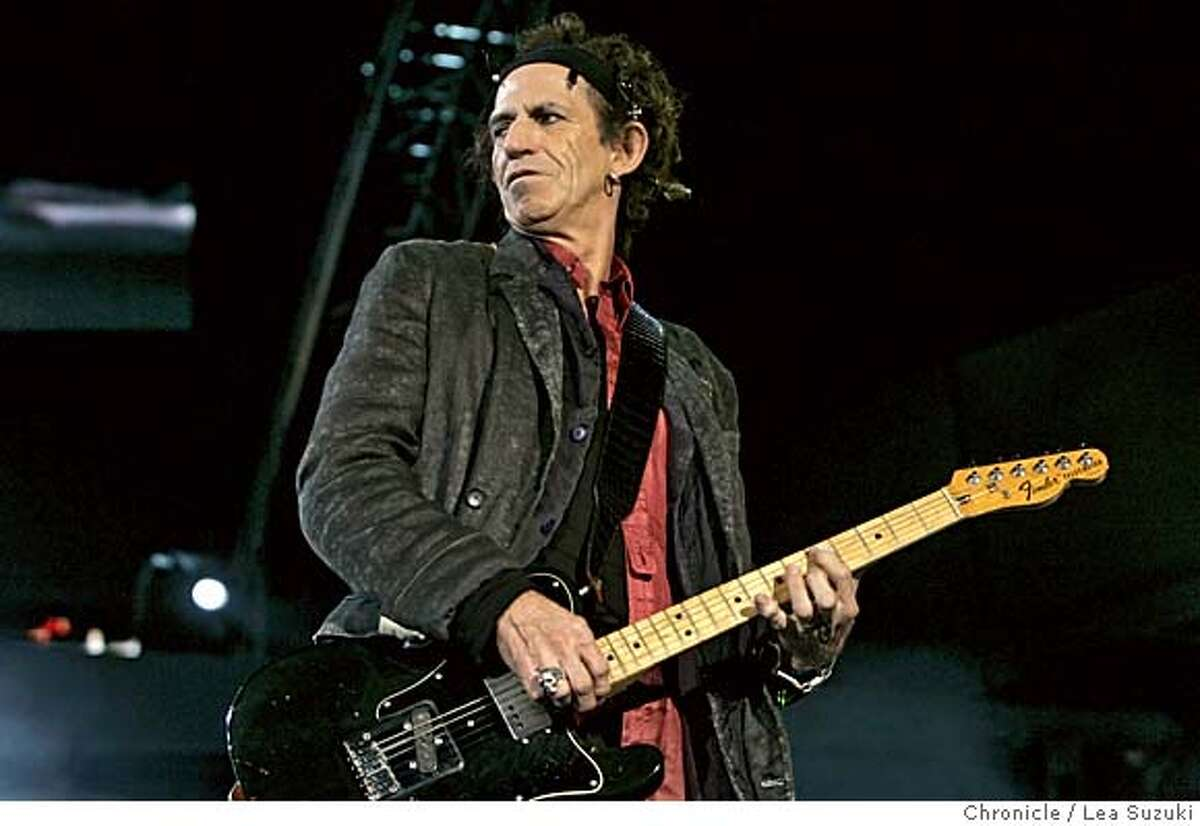 """rollingstones079_ls.JPG Keith Richards of the Rolling Stones performs at SBC. Rolling Stones perform at SBC. Two song limit - one from 70 feet back, other in pit. Ticket Pick-Up (1 ticket) ROLLING STONES """"A BIGGER BANG WORLD TOUR"""" Sunday, November 13, 2005 San Francisco, Calif. SBC Park Meeting Times: 5:30 pm to see opening act, Everclear 6:15pm to see opening act, Metallica 8:00pm for the Stones Location: Corner of 2nd and King Street, Side closest to the venue, under large South Beach Harbor sign Photo taken on 11/13/05 in San Francisco, CA. Photo by Lea Suzuki/ The San Francisco Chronicle /MAGAZINES OUT"""