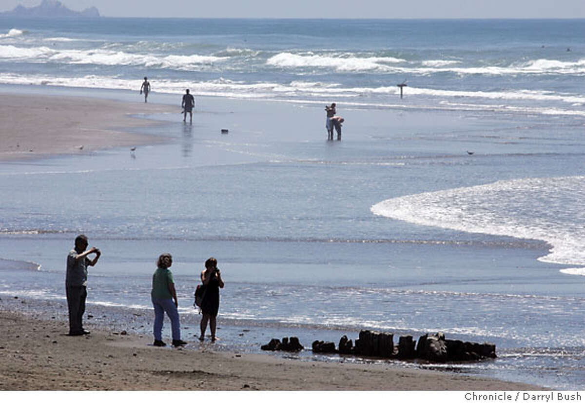 People view a portion of a wrecked 19th century clipper ship that has recently surfaced on Ocean Beach in San Francisco, CA, on Tuesday, May, 8, 2007. photo taken: 5/8/07 Darryl Bush / The Chronicle ** (cq)