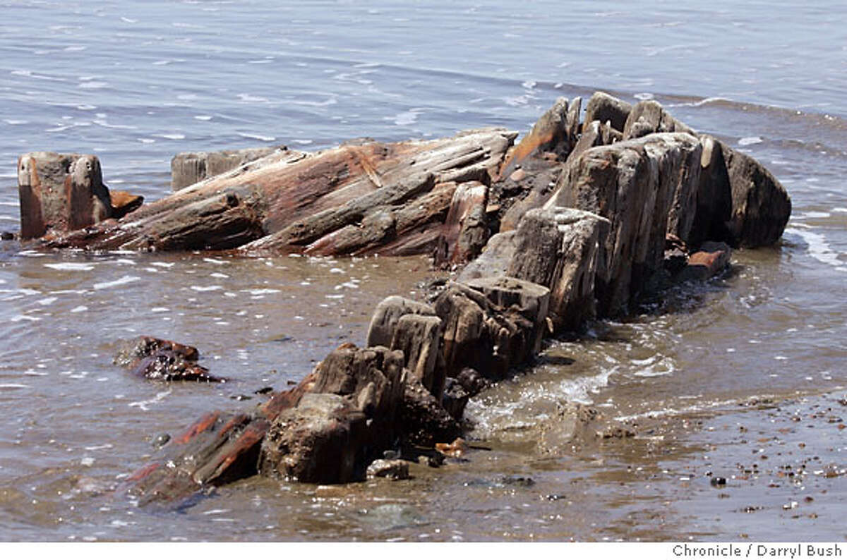 A portion of a wrecked 19th century clipper ship that has recently surfaced on Ocean Beach appears near the tide in San Francisco, CA, on Tuesday, May, 8, 2007. photo taken: 5/8/07 Darryl Bush / The Chronicle ** (cq)
