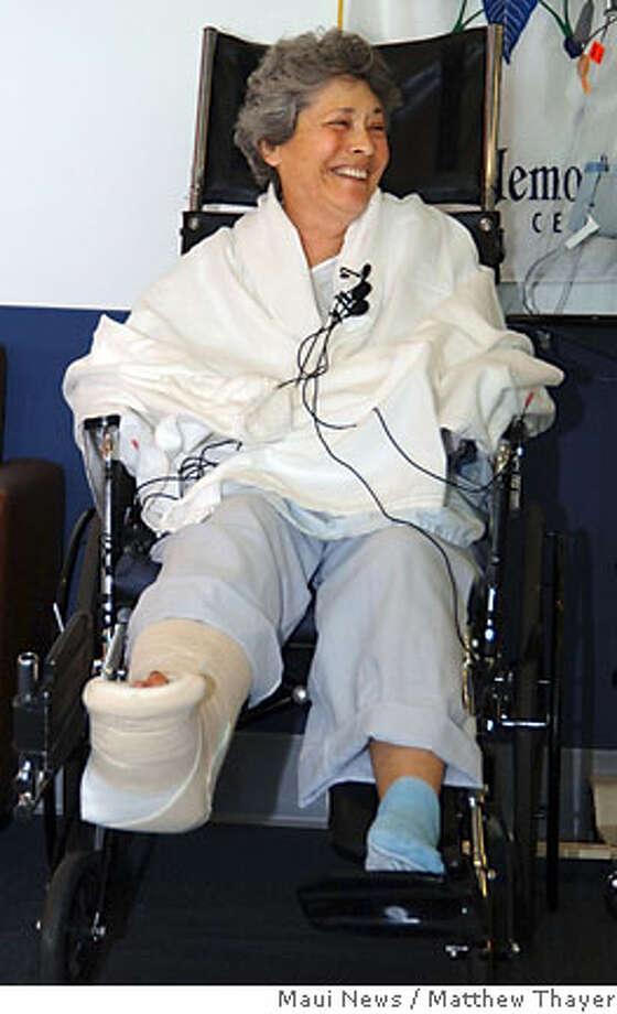 Shark attack victim Peller Marion, of San Francisco, laughs during a news conference Tuesday, May 8, 2007, at Maui Memorial Medical Center in Wailuku, Hawaii. (AP Photo/Maui News, Matthew Thayer) Photo: Matthew Thayer