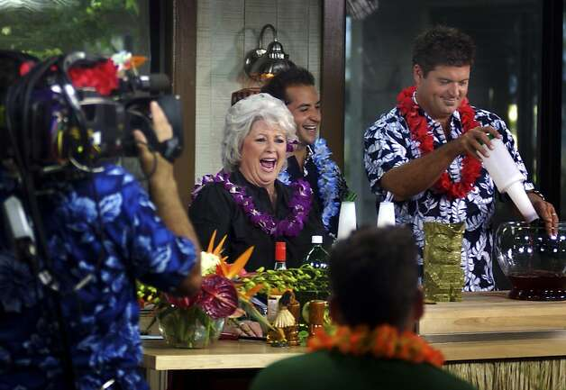 FILE-  This Thursday, July 27, 2006 file photo shows Paula Deen, center, and her sons Jamie, right, and Bobby, rear, as they tape her show in Savannah, Ga.   Paula Deen recently announced that she has Type 2 diabetes.  While Deen has cut out glass after glass of sweet tea and taken up treadmill walking off camera, she plans few changes on her three Food Network shows.   (AP Photo/Stephen Morton, File) Photo: Stephen Morton, Associated Press
