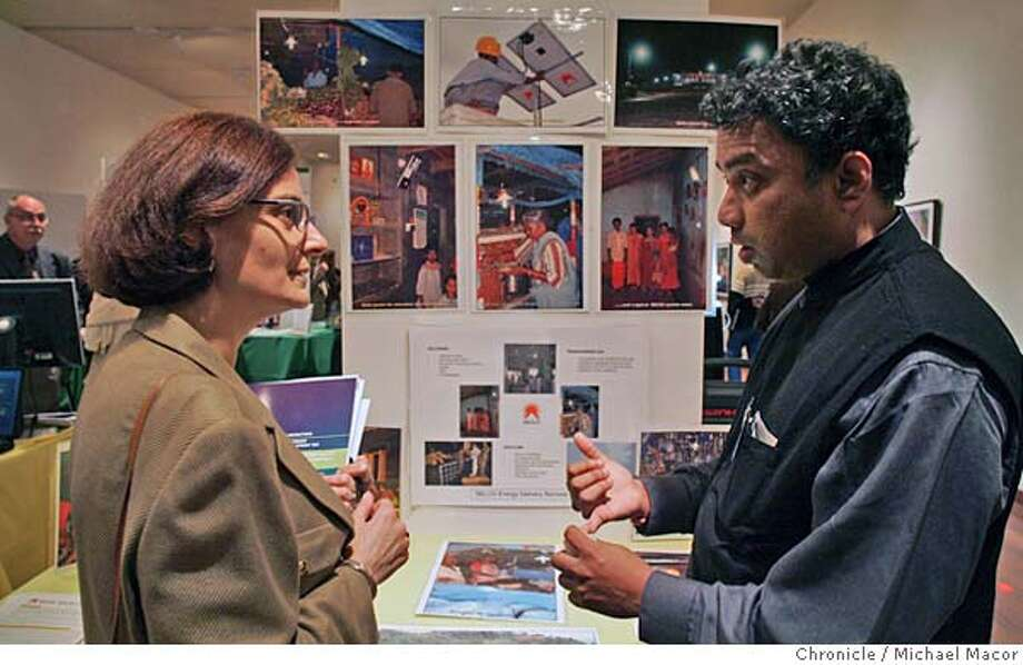 "techawards10_074_mac.jpg Harish Hande, managing director of ""Selco"" an Indian company that brings electricity to rural India through solar technology. He explains the company to Suzy Antounian. Selco was awarded the Accenture Economic Development Award for providing innovative technology solutions to overcome significant barriers to economic development in non -industrial countries. Finalists of the annual Tech Awards gather to show off their stuff at San Jose's Tech Museum. The program awards those who use technology to benefit humanity. Winners in each of the five categories will receive $50,000 in prize money. Event in San Jose, Ca on 11/9/05. Michael Macor / San Francisco Chronicle Mandatory Credit for Photographer and San Francisco Chronicle/ - Magazine Out Photo: Michael Macor"