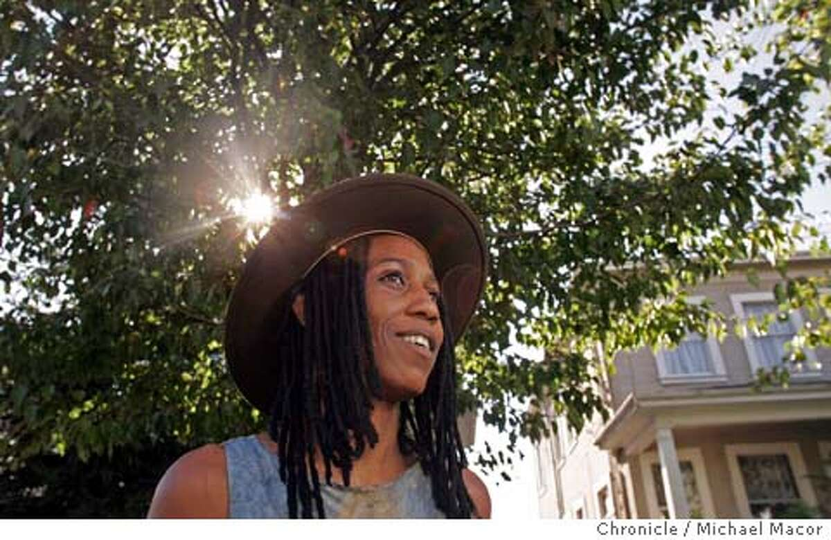 jashakur_033_mac.jpg Shakur in front of a tree she planted on 57th St. in Oakland, in memory of her mother who passed away 5 years ago. Jefferson Award winner, the founder of