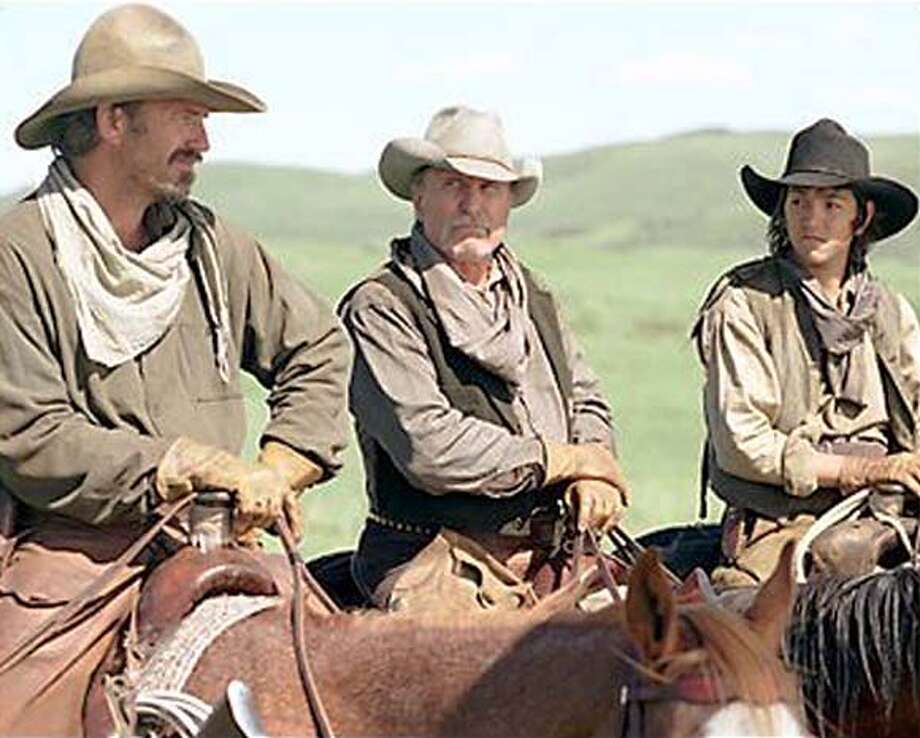 "OPEN RANGE  A decisive battle looms for freegrazers Charley (Kevin Costner, left), Boss (Robert Duvall, center) and Button (Diego Luna, right), who must also conquer their own personal demons in ""Open Range"" Photo: HO"