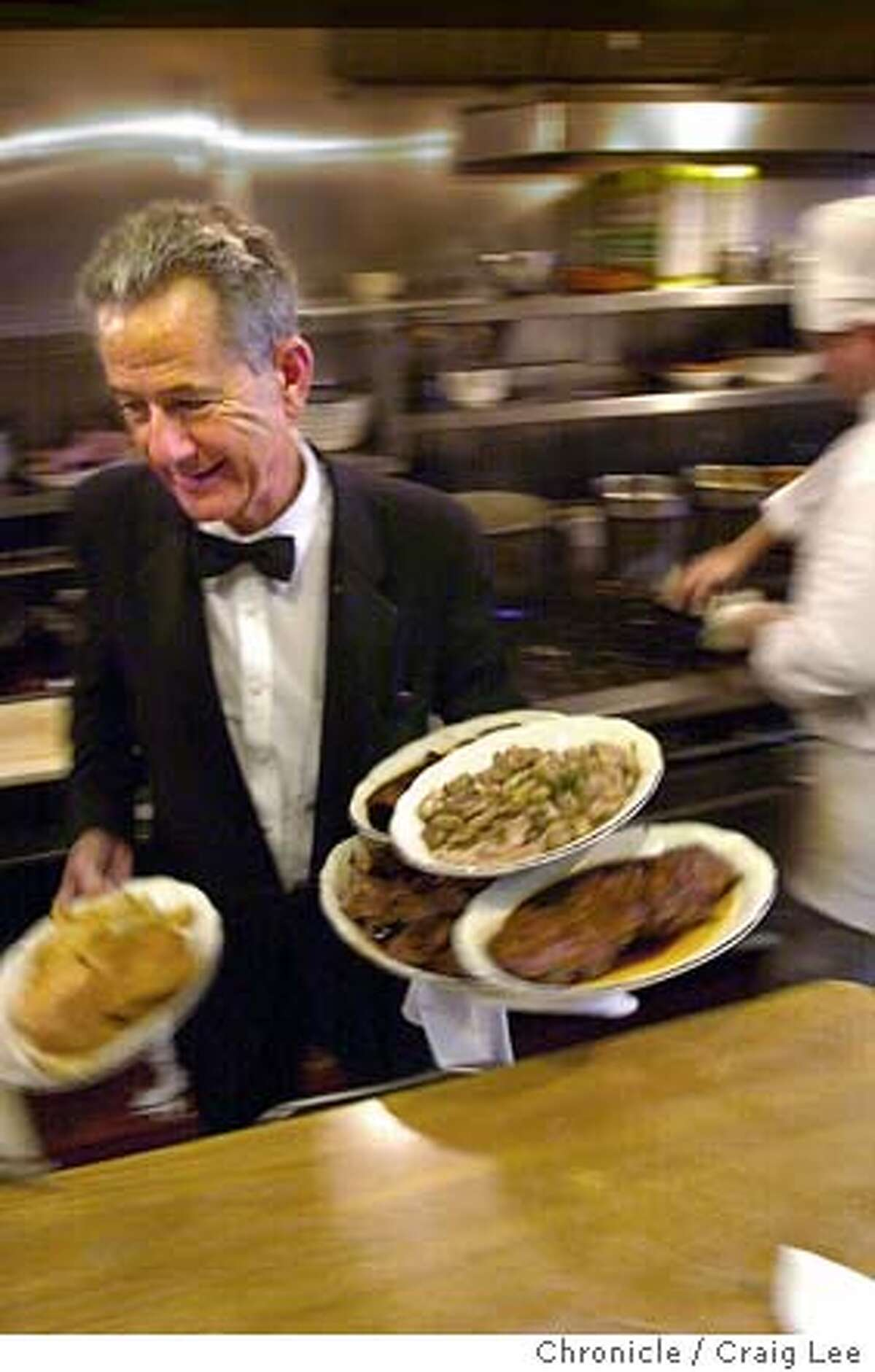 Original Joe's restaurant in the Tenderloin district of San Francisco. Photo of waiter, Angelo Viducic, age 63, hussling out a dinner order from the kitchen. He came to work there in 1960 at the age of 20 and has been there ever since. CRAIG LEE / The Chronicle