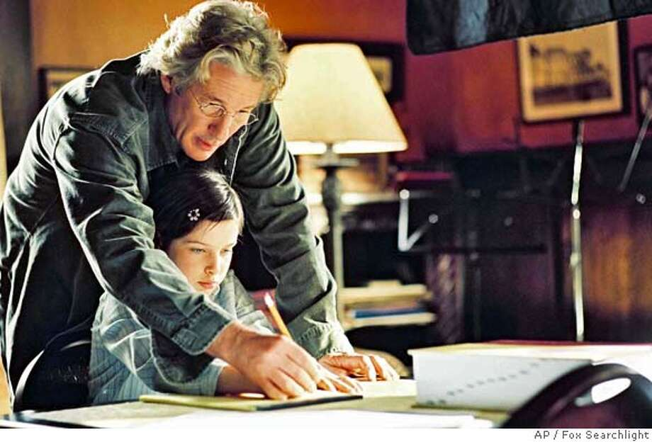 "In this photo provided by Fox Searchlight, Saul (Richard Gere) helps his daughter Eliza (Flora Cross) study for a spelling bee in ""Bee Season."" (AP Photo/Fox Searchlight) Photo: Fox Searchlight"