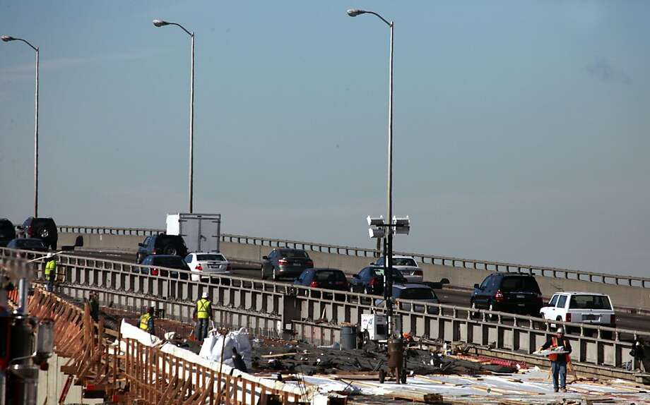 Ironworkers prepare the westbound roadway ramp in preparation for its use on Presidents weekend Tuesday, Jan. 15, 2012. The westbound deck of the Bay Bridge will be closed during the upcoming holiday weekend Photo: Lance Iversen, The Chronicle