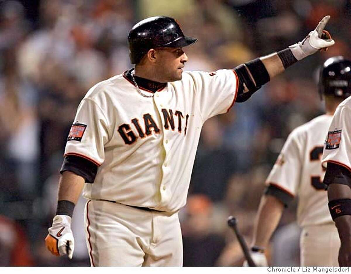 Giant Bengie Molina signals to the crowd after hitting his home run in the 5th inning. San Francisco Giants play the New York Mets in ATT Park on May 7, 2007. Liz Mangelsdorf/ The Chronicle