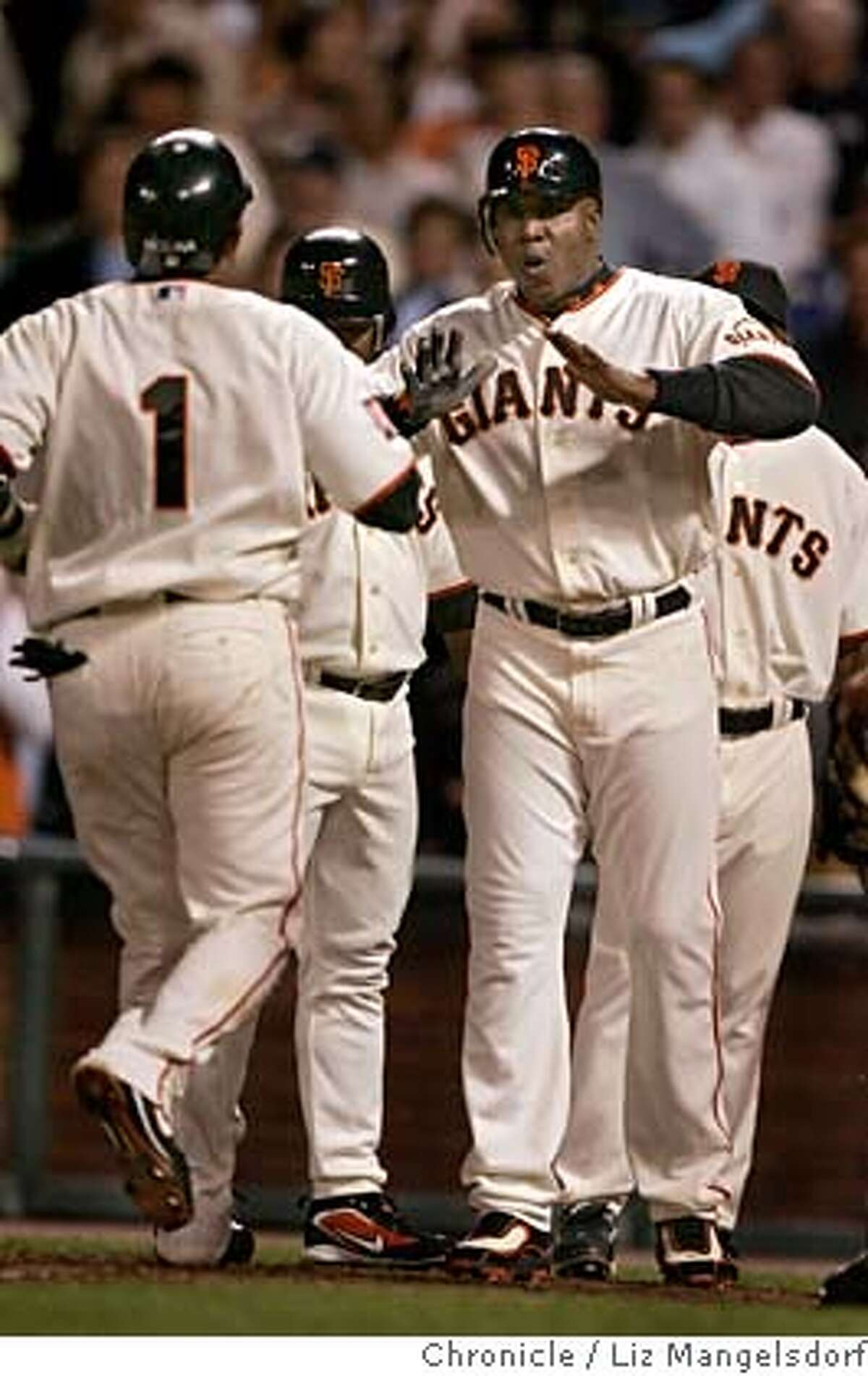 Barry Bonds greets Bengie Molina at home plate after Molina hits his second home run in the 5th inning. San Francisco Giants play the New York Mets in ATT Park on May 7, 2007. Liz Mangelsdorf/ The Chronicle