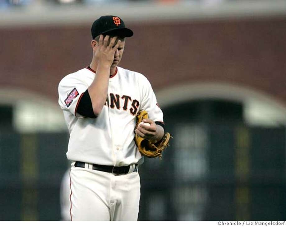 Pitcher Matt Cain wipes his face in the 1st inning, when the Mets scored 3 runs.  The Giants play the New York mets at ATT Park in San Francisco on May 8, 2007. Liz Mangelsdorf/ The Chronicle Photo: Liz Mangelsdorf