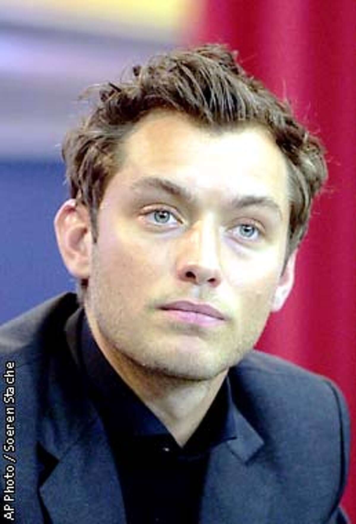 """Actor Jude Law during a press conference for the movie """"Enemy at the Gates"""" at the Berlinale Film Festival in Berlin, Germany on Feb. 7, 2001. (AP Photo/Soeren Stache)"""