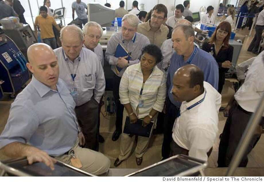 Ben Gurion Airport, Israel: May 8, 2007:  American airport officials receive a briefing at a security screening position by Yuval, an Israeli airport security official during the Airport Council International -North American visit to Israel. Participants from California include Steven J. Grossman (2nd from right, front, blue shirt), Director of Aviation for the Port of Oakland and Thella F. Bowens (3rd from right, front), the President and CEO of San Diego County Regional Airport Authority. David Blumenfeld/Special to The Chronicle  Ran on: 05-10-2007  American airport officials receive a briefing at a security screening position by Yuval (left), an Israeli airport security official, at Ben-Gurion Airport. Participants from California include Steven Gross- man (second from right) of Oakland and Thella Bowens (third from right) of San Diego.  Ran on: 05-10-2007  American airport officials receive a briefing at a security screening position by Yuval (left), an Israeli airport security official, at Ben-Gurion Airport. Participants from California include Steven Gross- man (second from right) of Oakland and Thella Bowens (third from right) of San Diego. Photo: David Blumenfeld