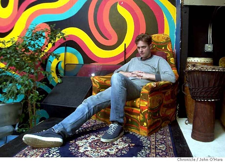 "Berkeley's Jesse Reklaw has been drawing ""Slow Wave,"" which he describes as a collective dream diary, since 1995. Scores of people write him abt their dreams each week and he turns them into a comic strip which runs in papers around the country. We photograph him at his home art studio. photo/John O'harra Photo: JOHN O'HARA"