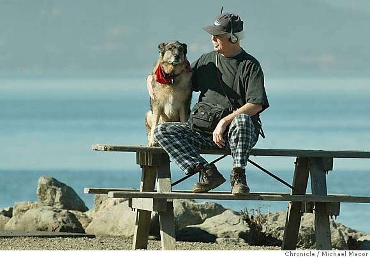 parksdogs083_mac.jpg Dog owner Harold Parrish with his dog