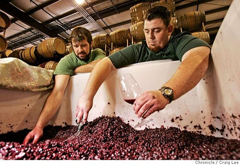 SBARBARA10.s1_144_cl.JPG  Wine section cover story on winemakers in Santa Barbara County. Photo of McPrice Myers (right) and Russell From (left), both young guys making wine separately as McPrice Myers Wine Co. and Herman Story Wines in Santa Maria. They both make a wine together called Barrel 27. Photo of them checking out some of their Grenache grapes.  Event on 11/1/05 in Santa Maria. Craig Lee / The Chronicle MANDATORY CREDIT FOR PHOTOG AND SF CHRONICLE/ -MAGS OUT Photo: Craig Lee
