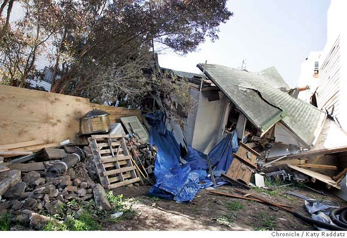 SHOWN: The back view of the small house at 149 Mangels St. in San Francisco that fell down the hillside lot it is built on, and collapsed and twisted during that fall. Demian Bulwa is the reporter for Metro. These pictures were made in San Francisco, CA. on Sunday, May 6, 2007. (Katy Raddatz/The Chronicle) **