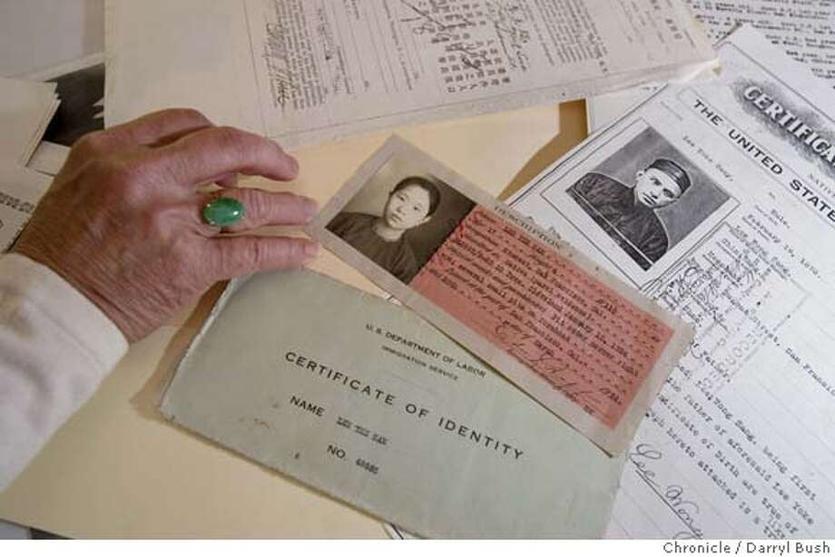 exclusion06_0001_db.JPG  Connie Young Yu sorts through documents of her family in her home. Shown here is Yu's mother written as Lee Yee Sam on a Certificate of Identity issued in 1924. Yu's grandfather's certificate written as Yoke Suey Lee is at upper right. in Los Altos Hills, CA, on Friday, April, 27, 2007. photo taken: 4/27/07  Darryl Bush / The Chronicle ** Connie Young Yu, Lee Yee Sam, Yoke Suey Lee (her relatives have their surnames first on the documents) (cq) MANDATORY CREDIT FOR PHOTOG AND SF CHRONICLE/NO SALES-MAGS OUT Photo: Darryl Bush