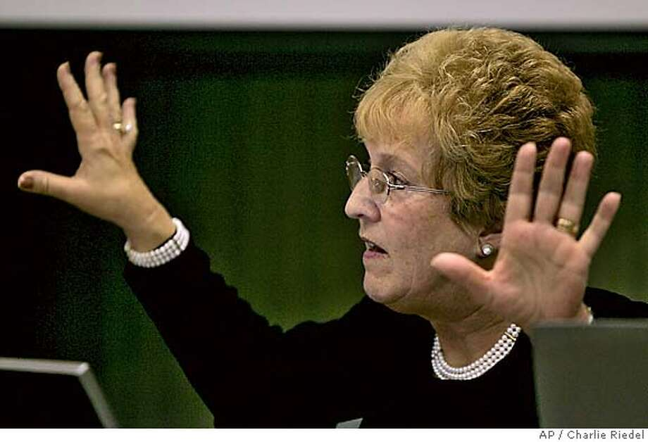Board member Janet Waugh speaks against changes in science standards during a meeting of the Kansas Board of Education Tuesday, Nov. 8 2005, in Topeka, Kan. The board voted 6-4 to adopt science standards that cast doubt on the theory of evolution. (AP Photo/Charlie Riedel) Photo: CHARLIE RIEDEL