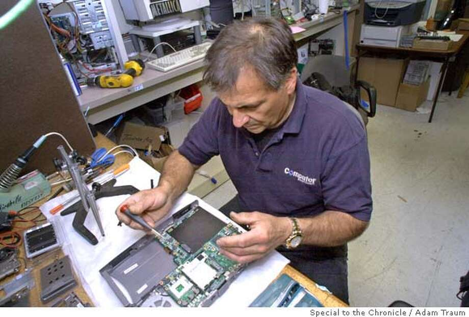 � Dan Mirabella re-assambles a laptop computer at Computer Renaissance. Consumer's Checkbook highly rated Computer Renaissance in Pleasant Hill as bright spot for local computer computer repairs. Photo by Adam Traum/The San Francisco Chronicle Photo: Adam Traum/The San Francisco Chr
