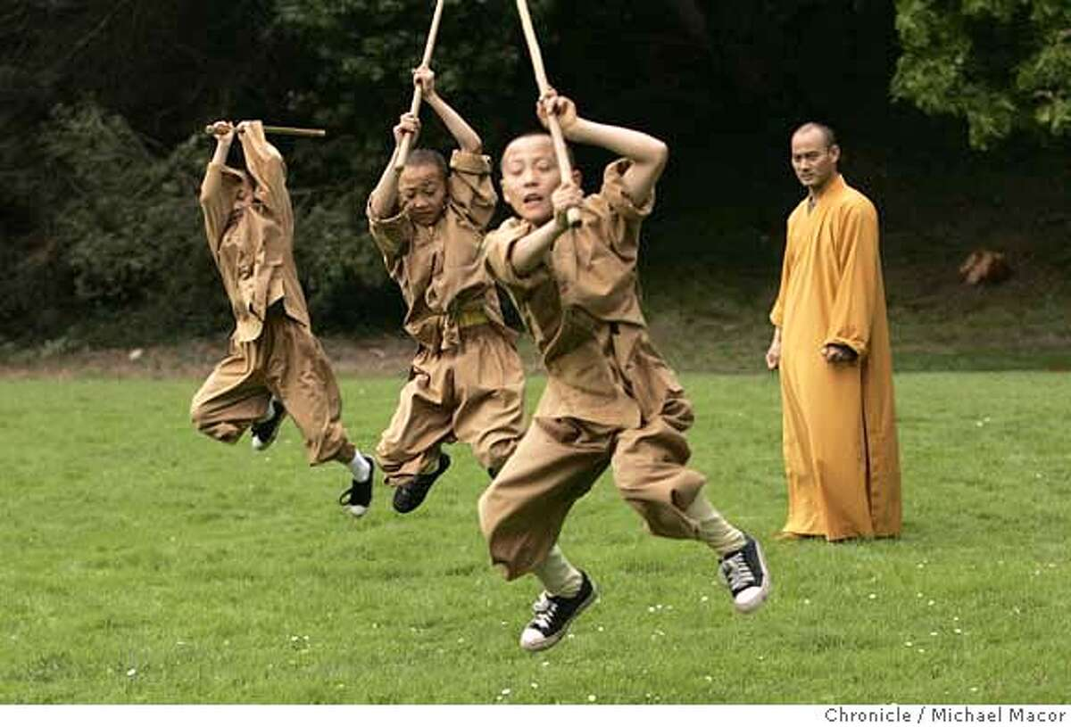 shaolin1_267_mac.jpg Shi GuoSong watches his students, Shi LongHu, Shi HuHu and Shi BaoHu, as they perform Shaolin exercises in Golden Gate Park. Shaolin Monks from China now making their home in San Francisco. They are trying to keep alive the 1500 year old traditions of the Shaolin Monks. Photographed in, San Francisco, Ca, on 10/3/06. Photo by: Michael Macor/ The Chronicle