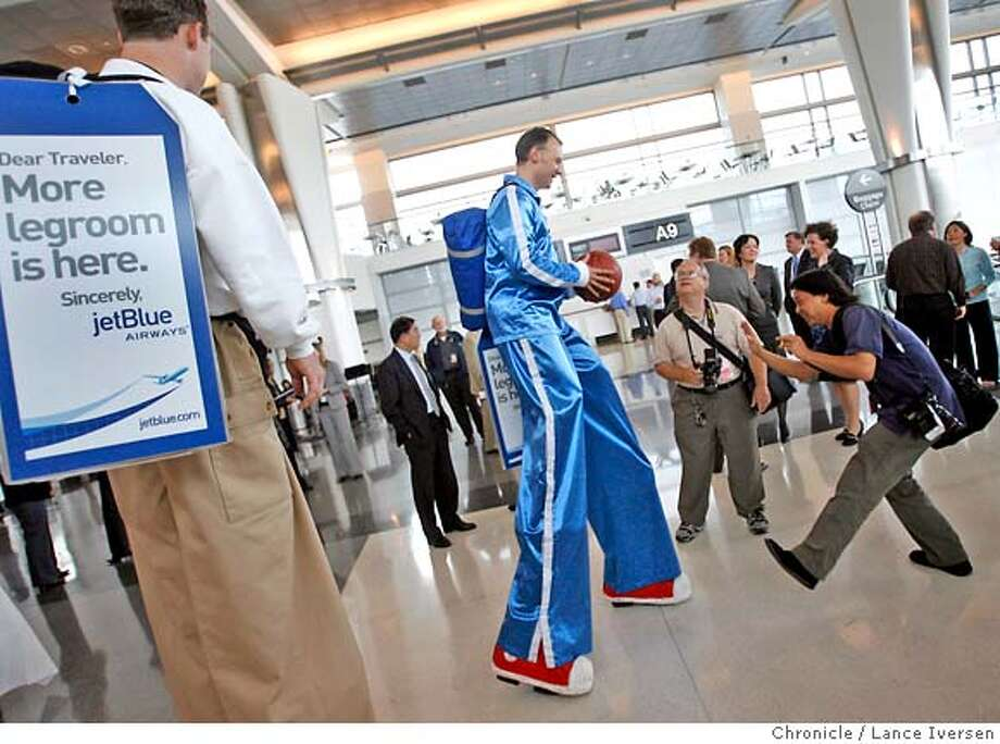 JETBLUE04_28076.JPG  Stilt-walkers joke around with photographers at a reception sponsored by JetBlue Airways, who hired stilt walkers to promote their inaugural flight between New York�s JFK and San Francisco International airport Thursday. (MAY 3) (cq, JETBLUE ) Photo By Lance Iversen / The Chronicle Photo taken on 5/03/07, in SOUTH SAN FRANCISCO, CA. MANDATORY CREDIT PHOTOG AND SAN FRANCISCO CHRONICLE/NO SALES MAGS OUT Photo: By Lance Iversen