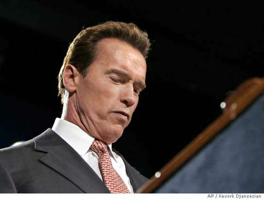 California Governor Arnold Schwarzenegger speaks to supporters at his election night party in Los Angeles, November 8, 2005. Schwarzenegger lost his bid to push through a broad package of government reforms in a special off-year election on Tuesday that he called in an attempt to flex his political muscles. With more than 85 percent of the votes counted, Schwarzenegger trailed on all four of the initiatives he had championed, and four other measures also appeared to have lost. REUTERS/Kevork Djansezian/Pool Photo: POOL
