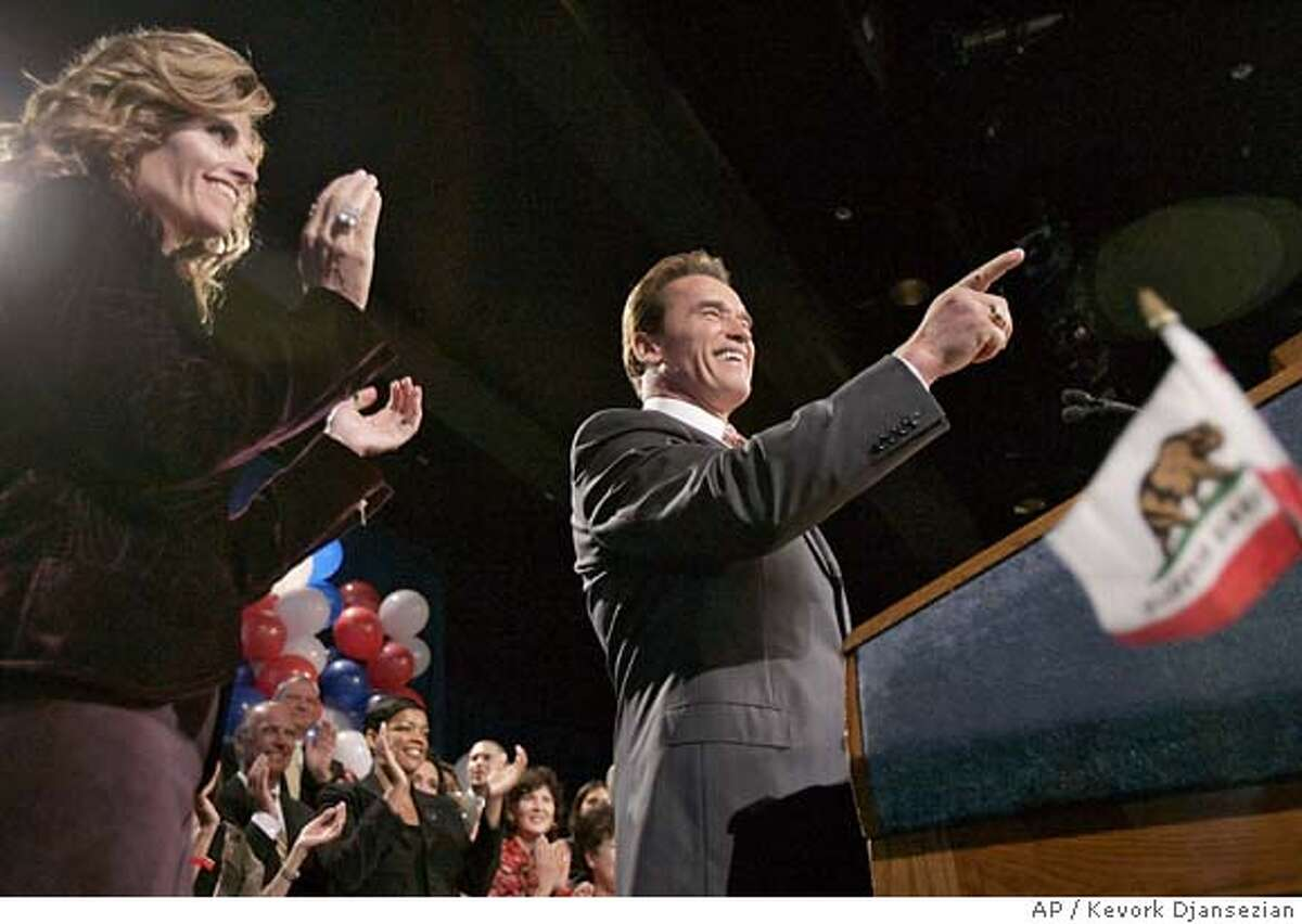 Gov. Arnold Schwarzenegger speaks to the crowd at his election night party in Los Angeles, Tuesday, Nov. 8, 2005, as his wife Maria Shriver applauds him, left. The fifth statewide special election in state history pits the Republican actor-turned-governor against two of California's dominant political forces, labor unions and the Democrats who control both houses of the Legislature. (AP Photo/Kevork Djansezian) Ran on: 11-09-2005 Gov. Arnold Schwarzenegger speaks to the crowd at his election night party in Los Angeles as his wife, Maria Shriver, applauds (left).