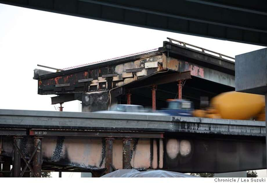 Traffic moves along the connector from westbound Interstate 80 to southbound I-880.  Top connector, which collapsed in the fire, can be seen in background.  The connector from westbound Interstate 80 to southbound I-880 reopened Monday morning.  Photo taken on 5/7/07 in Oakland, CA.  Photo by Lea Suzuki/ The Chronicle  ()cq Photo: Lea Suzuki