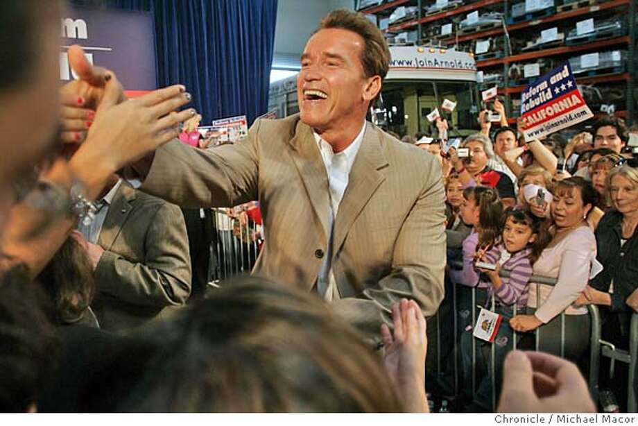 """Working the crowd following his talk to supporters. Governor Arnold Schwarzenegger begins his, """"Reform to Rebuild"""" tour of Southern California, in support of his propositions coming up on next weeks election. Second stop Pacific Transformer in Anaheim, Ca. 11/5/05 Anaheim, Ca. Michael Macor / San Francisco Chronicle Photo: Michael Macor"""
